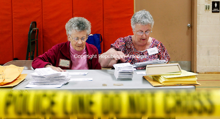 WINSTED, CT- 06, November 2010-110610CM02 Beverly Brentall (left) and Carol Grant count absentee ballets behind a secure area inside the gymnasium of Pearson Middle School in Winsted.  The pair were part of a group of registrars and poll workers recounting ballots from the 63rd House District seat race. Republican John B. Rigby defeated his Democratic challenger, William O. Riiska by a margin of 38 votes, forcing a state mandated recount.  Christopher Massa Republican-American