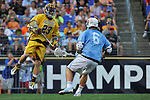 29 MAY 2011:  Tony Mendes (23) of Salisbury University moves the ball against Matt Witko (6) of Tufts University during the Division III Men's Lacrosse Championship held at M+T Bank Stadium in Baltimore, MD.  Salisbury defeated Tufts 19-7 for the national title. Larry French/NCAA Photos