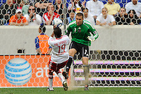 Philadelphia Union Chris Seitz clears a ball as Dane Richards (19) of the New York Red Bulls protects himself. The New York Red Bulls defeated the Philadelphia Union 2-1 during a Major League Soccer (MLS) match at Red Bull Arena in Harrison, NJ, on April 24, 2010.