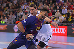 VELUX EHF 2017/18 EHF Men's Champions League Group Phase - Round 11.<br /> FC Barcelona Lassa vs HC Vardar: 29-28.<br /> Timothey N'Guessan vs Mijajlo Marsenic.