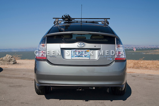 Rear view of Kendrick Li's 2004 Toyota Prius has a '56 MPG' (56 miles per gallon) custom license plate. People pay for the customized plates and the proceeds support various causes. The fees collected for these Whale Tail License Plates support the California Coastal Commission environmental projects. Li was inspired to get the plate because the Prius was rated at 40 to 60 miles per gallon fuel economy. By the time he purchased the plate all of the other numbers between 40 and 60 had been taken. He admits his Prius does get less than 56 MPG but it's still very fuel efficient and the new models are even better. California, USA