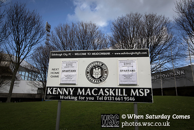 Edinburgh City v Spartans, 11/04/2015. Commonwealth Stadium, Scottish Lowland League. A sign advertising the Scottish Lowland League match between Edinburgh City and city rivals Spartans at the Commonwealth Stadium, Meadowbank, which was won by the hosts by 2-0. Edinburgh City were the 2014-15 league champions and progressed to a play-off to decide whether there would be a club promoted to the Scottish League for the first time in its history. The Commonwealth Stadium hosted Scottish League matches between 1974-95 when Meadowbank Thistle played there. Photo by Colin McPherson.