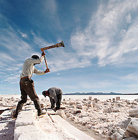 Miners working at a Salt mine on Salar de Uyuni salt flats, Bolivia. The Salar de Uyuni are the worlds largest salt flats.