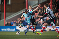 Matt Bloomfield of Wycombe Wanderers hits a shot at goal during the Sky Bet League 2 match between Grimsby Town and Wycombe Wanderers at Blundell Park, Cleethorpes, England on 4 March 2017. Photo by Andy Rowland / PRiME Media Images.