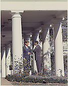 United States President John F. Kennedy confers with US Secretary of Defense Robert S. McNamara on the West Wing Colonade at the White House in Washington, DC on October 29, 1962. <br /> Credit: White House via CNP