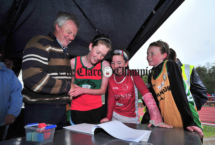 Vincent Mc Carthy at the winners table with Emer Hillery, Niamh O' Brien and Shannon O' Grady during the Clare Athletic Association juvenile track and field championships at Lees Road. Photograph by Declan Monaghan