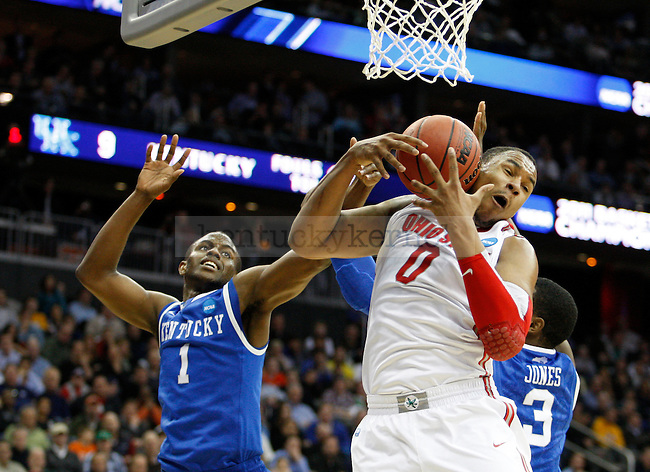 Darius Miller goes against Jared Sullinger for a rebound in the second half of UK's Sweet 16 NCAA tournament game against Ohio State at the Prudential Center in Newark, New Jersey on Friday, March 25, 2011.  Photo by Britney McIntosh | Staff