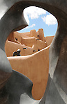 """pvc042511c/4-25-11/north.  The New Mexico Museum of Art is seen through the center of an Allan Houser bronze sculpture entitled """"Migration"""" photographed Monday April 25, 2011.  The sculpture is situated on Lincoln Street in Santa Fe.   (Pat Vasquez-Cunningham/Journal)"""