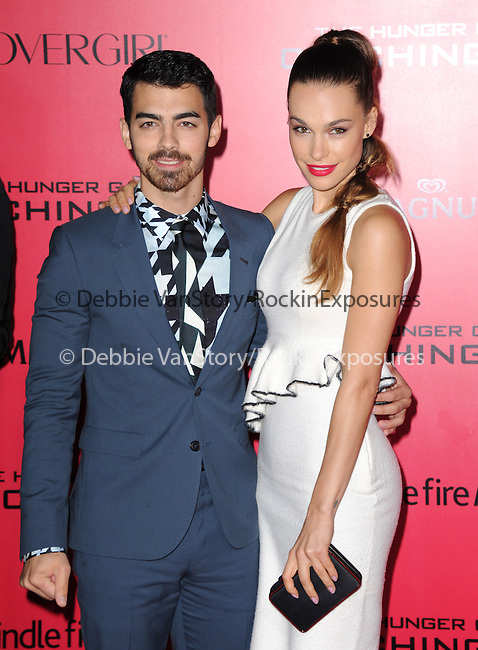 LOS ANGELES, CA - NOVEMBER 18: Joe Jonas and Blanda Eggenschwiler arrives at   THE HUNGER GAMES: CATCHING FIRE L.A. Premiere held at Nokia Live  in Los Angeles, California on November 18,2012                                                                               © 2013  Hollywood Press Agency