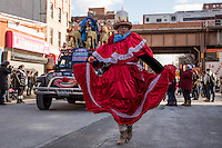 NEW YORK - JANUARY 06: A woman dance dance during Three Kings Day Parade in East Harlem January 6, 2017 in New York City. The parade celebrates the Feast of the Epiphany, also known as Three Kings Day, marking the Biblical story of the visit of three kings to Bethlehem to visit the baby Jesus, revealing his divinity. Photo by VIEWpress/Maite H. Mateo
