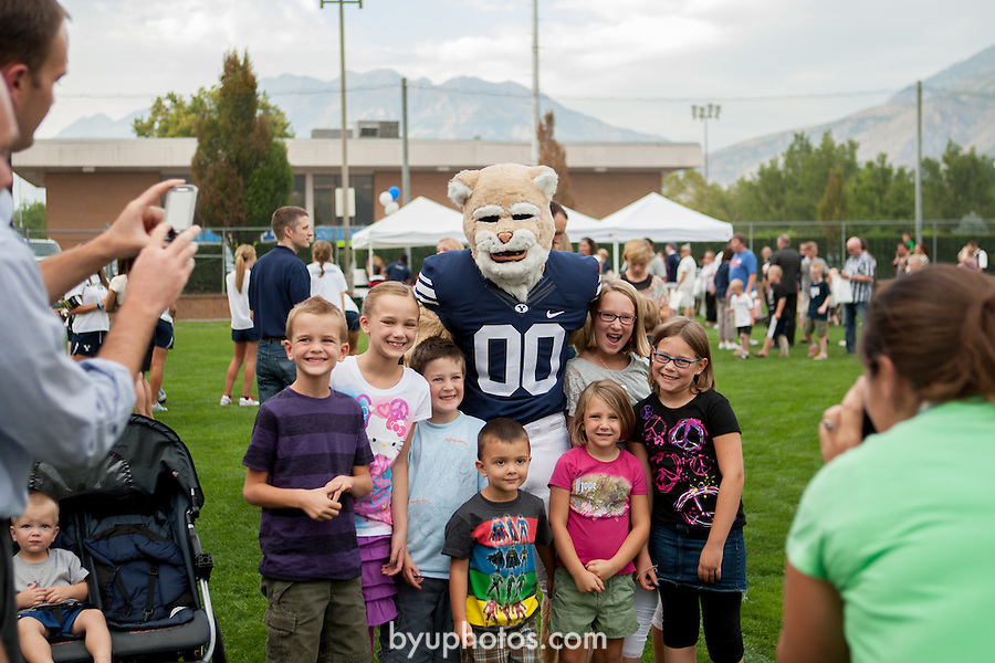 1208-62 030<br /> <br /> 1208-62 BYU Athletes and Cosmo spend time with fans at the 2012 Cougar Kickoff. Live Music provided by the Blind Actuaries.<br /> <br /> August 22, 2012<br /> <br /> Photo by Bella Torgerson<br /> <br /> &copy; BYU PHOTO 2012<br /> All Rights Reserved<br /> photo@byu.edu  (801)422-7322
