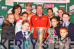 Celebrations: Holding the  Heineken Cup at the Listowel Community Centre last Thursday was Munster's Ray Gadsden surrounded by Listowel children Serena Downey, Adi Canty, Alfred Fazilov, Lenelly Hricko, Alex Zoric, Roman Hricko, Sarah Hobbert, Nicola Flavin, Ilvina Fazilova with Dee Keogh, Equlity Officer with North Kerry Together.   Copyright Kerry's Eye 2008