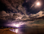 A lightning storm moves along the Forgotten Coast during a full moon at Shell Point in Waklulla County, Florida in the Florida panhandle.<br />