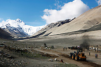 A bulldozer belches smoke as it clears a road to everest base camp.<br /> China started building a controversial 67-mile &quot;paved highway fenced with undulating guardrails&quot; to Mount Qomolangma, known in the west as Mount Everest, to help facilitate next year's Olympic Games torch relay.<br /> Tibet, China<br /> July, 2007