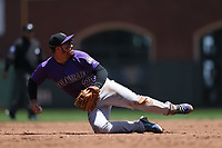 SAN FRANCISCO, CA - JUNE 28:  Nolan Arenado #28 of the Colorado Rockies makes a play at third base against the San Francisco Giants during the game at AT&T Park on Wednesday, June 28, 2017 in San Francisco, California. (Photo by Brad Mangin)