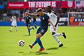 February 2nd 2019, San Jose, California, USA; USA midfielder Paul Arriola (14) passes under pressure from Costa Rica defender Keysher Fuller (4) during the international friendly match between USA and Costa Rica at Avaya Stadium on February 2, 2019 in San Jose CA.
