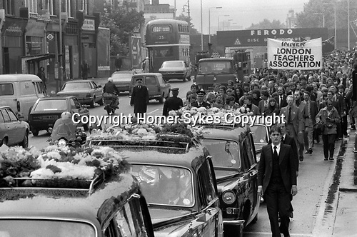 Blair Peach funeral Southall west London 1979. The funeral cortege makes its way along through Southall on route to the cemetery.  10,000 took part. Blair Peach was an active member of both the anti Nazi League and the Inner London Teachers Association.