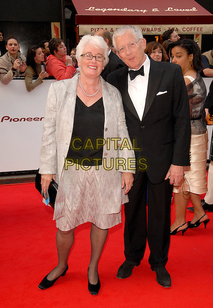 MARGARET MOUNTFORD & NICK HEWER of The Apprentice.Red Carpet Arrivals at The British Academy Television Awards (BAFTA) Sponsored by Pioneer, held at the London Palladium, London, England, May 20th 2007..full length .CAP/FIN.©Steve Finn/Capital Pictures.