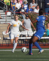 Western New York Flash midfielder McCall Zerboni (7) brings the ball forward.  In a National Women's Soccer League (NWSL) match, Boston Breakers (blue) tied Western New York Flash (white), 2-2, at Dilboy Stadium on August 3, 2013.