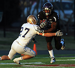 ROME, GA - DECEMBER 18: Chevon Walker #29 of the University of Sioux Falls tries to cut back against Tucker Vezina  #27 of Carroll College in the first quarter at Barron Stadium in the 2010 NAIA National Football Championship in Rome, GA.(photo by Dave Eggen/Inertia)