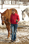 A young woman walks her horse in Wilson, Wyoming.