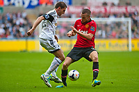 Saturday 17 August 2013<br /> <br /> Pictured: Angel Rangel  challenges Tom Cleverley of Manchester United<br /> <br /> Re: Barclays Premier League Swansea City v Manchester United at the Liberty Stadium, Swansea, Wales
