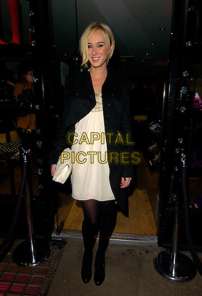 KIMBERLY STEWART.Mascaro - store launch party, Mascaro, Marylebone High Street, London, England..November 19th, 2007.full length kimberley white cream dress black tights mary janes shoes heels clutch bag purse coat jacket  .CAP/CAN.©Can Nguyen/Capital Pictures