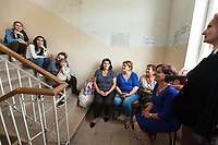 """Nagorno-Karabakh, also known as Artsakh, is a landlocked region in the South Caucasus. Stepanakert is the capital and the largest city of the Republic of Artsakh (better known as Nagorno-Karabakh). Hospital. """"Mother and Children Healthcare Center"""". A group of women wait outside the maternity ward. Nagorno-Karabakh is a disputed territory, internationally recognized as part of Azerbaijan, but most of the region is governed by the Republic of Artsakh (formerly named Nagorno-Karabakh Republic), a de facto independent state with Armenian ethnic population.  Since 1994, regular peace talks between Armenia and Azerbaijan mediated by the OSCE Minsk Group have failed to result in a peace treaty.  7.10.2019 © 2019 Didier Ruef"""