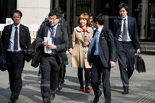Japanese artist Megumi Igarashi (C) leaves the Tokyo District Court on April 13, 2017, Tokyo, Japan. Igarashi also known as Rokudenashiko was declared partly innocent by the Tokyo District Court, today April 13, after first being arrested in 2014 for distributing 3D data of her genitals as part of a crowd funding project to make a kayak based on her vulva. She had been found guilty in 2016 of breaking obscenity laws and fined JPY 400,000 but appealed that ruling. She was found guilty of distributing obscene data via the internet but innocent for displaying her art. Her fiancé Mike Scott of The Waterboys was also in Tokyo to attend the hearing. (Photo by Rodrigo Reyes Marin/AFLO)