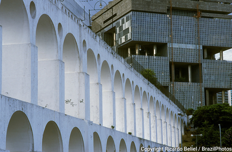 The Arcos da Lapa ( Lapa Arches or Lapa aqueduct ) with the Petrobras Building to the right in the background, Rio de Janeiro, Brazil. A Roman-style aqueduct from the mid-eighteenth-century with 42 arches in two tiers - from Brazil's Colonial period.  It has been converted into a tramway.