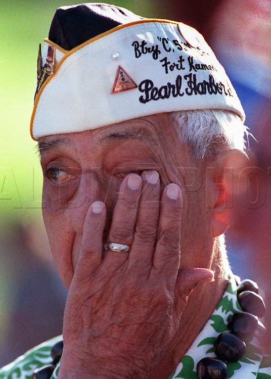 "Dec. 7th 1991--Al Diaz/Herald Staff--Pearl Harbor memorial service 50th anniversary. ""It gets me deep down"" Survivor Hazelett Villa of Lauderdale Lakes, as President Bush lays wreath at the National Memorial Cemetery of the Pacific in Honolulu."