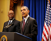 United States President Barack Obama makes a statement to the press regarding the US-Korea Trade Agreement, as US Trade Representative Ron Kirk looks on from left, in the Old Executive Office Building on Saturday, December 4, 2010, in Washington, DC.  .Credit: Leslie E. Kossoff - Pool via CNP