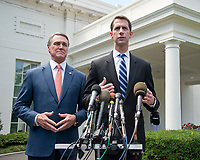 United States Senator David Perdue (Republican of Georgia), left, and US Senator Tom Cotton (Republican of Arkansas), right, speak to reporters outside the White House after meeting US President Donald J. Trump to discuss their proposed legislation to enact a skills-based immigration system called the Reforming American Immigration for a Strong Economy (RAISE) Act that they claim would also result in a lower level of immigration.<br /> Credit: Ron Sachs / CNP / MediaPunch
