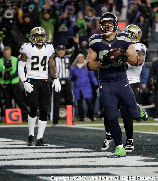 Seattle Seahawks tight end Zach Miller (86) runs into the end zone after catching a Russell Wilson pass for a touchdown against the   New Orleans Saints during the first quarter at CenturyLink Field in Seattle, Washington on December 2, 2013.The Seahawks beat the Saints 34-7 to take the best record team in the NFL.©2013. Jim Bryant Photo. ALL RIGHTS RESERVED.