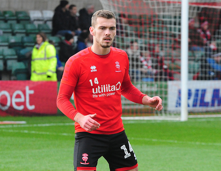 Lincoln City's Harry Toffolo during the pre-match warm-up<br /> <br /> Photographer Andrew Vaughan/CameraSport<br /> <br /> The EFL Sky Bet League Two - Lincoln City v Mansfield Town - Saturday 24th November 2018 - Sincil Bank - Lincoln<br /> <br /> World Copyright © 2018 CameraSport. All rights reserved. 43 Linden Ave. Countesthorpe. Leicester. England. LE8 5PG - Tel: +44 (0) 116 277 4147 - admin@camerasport.com - www.camerasport.com