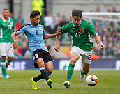 June 4th 2017, Aviva Stadium, Dublin, Ireland; International football friendly, Republic of Ireland versus Uruguay; Jonathan Urretaviscaya (Uruguay) and Harry Arter (Republic of Ireland) challenge for the ball