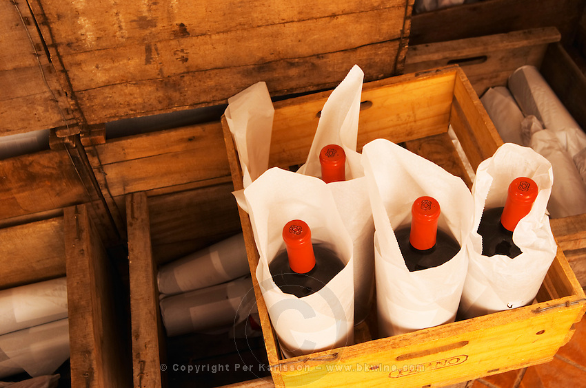 Bottles of wines in wooden crates wrapped in paper ready to be sent off. Bodega Pisano Winery, Progreso, Uruguay, South America