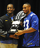 Roosevelt High School senior Chukwuma Ukwu, left, gets presented with the Heart of a Giant Award by New York Giants running back Rashad Jennings during a surprise ceremony for Ukwu in the school's auditorium on Tuesday, Dec. 15, 2015. Ukwu, who played on Roosevelt's varsity football team, was honored for his dedication on the gridiron and exceptional service to his local community.