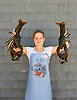 Rachel West displays two 6 1/2 pound lobsters at Hall's Harbour Lobster Pound in Hall's Harbour, Nova Scotia. Photo by Kevin J. Miyazaki/ReduxPhoto by Kevin J. Miyazaki/Redux
