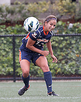 Pepperdine University defender Kristin DeGrandmont (12) heads the ball. Pepperdine University defeated Boston College,1-0, at Soldiers Field Soccer Stadium, on September 29, 2012.