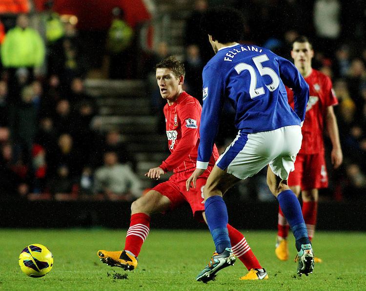 Southampton's Steven Davis passes the ball from Everton's Marouane Fellaini..- Credit - CameraSport - James Marsh - ..Football - Barclays Premiership - Southampton v Everton - Monday 21st January 2013 - St Mary's - Southampton..