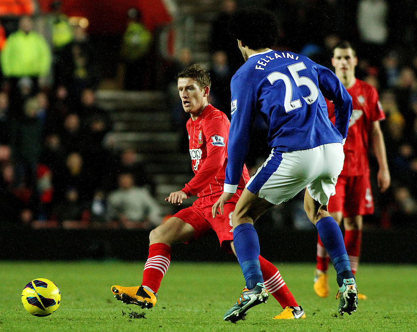 Southampton's Steven Davis passes the ball from Everton's Marouane Fellaini..- Credit - CameraSport - James Marsh - ..Football - Barclays Premiership - Southampton v Everton - Monday 21st January 2013 - St Mary's - Southampton..