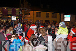 Santa greeting awaiting children in Abbeyfeale on Friday night where he turned on the Christmas Lights.