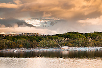 Sunset over Five MIle Lagoon near Okarito with Franz Josef Glacier visible under clouds, Westland Tai Poutini National Park, UNESCO World Heritage Area, West Coast, New Zealand, NZ