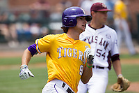 LSU Tigers outfielder Mark Laird (9) runs to first base against the Texas A&M Aggies in the NCAA Southeastern Conference baseball game on May 11, 2013 at Blue Bell Park in College Station, Texas. LSU defeated Texas A&M 2-1 in extra innings to capture the SEC West Championship. (Andrew Woolley/Four Seam Images).