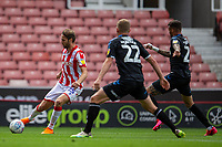 27th June 2020; Bet365 Stadium, Stoke, Staffordshire, England; English Championship Football, Stoke City versus Middlesbrough; Nick Powell of Stoke City crosses the ball in front of George Saville of Middlesbrough