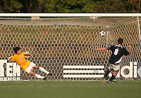 04 September 2009: Michael Thomas #8 of the University of Notre Dame sends Akira Fitzgerald #1 of Wake Forest University the wrong way to score from the penalty spot during an Adidas Soccer Classic match at the University of Indiana in Bloomington, In. The game ended in a 1-1 tie..