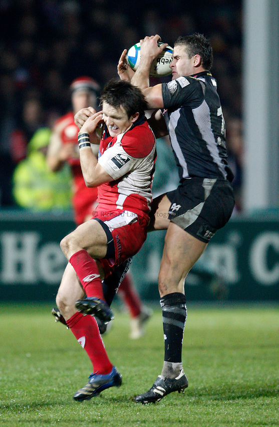 Photo: Richard Lane/Richard Lane Photography..Gloucester Rugby v Ospreys. Heineken Cup. 16/11/2007. .Opsreys' Lee Byrne wins a high ball as Gloucester's Rory Lawson challenges.