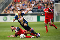 Roger Torres (8) of the Philadelphia Union flies over the tackle of  Torsten Frings (22) of Toronto FC. The Philadelphia Union defeated Toronto FC 3-0 during a Major League Soccer (MLS) match at PPL Park in Chester, PA, on July 8, 2012.