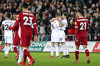Federico Fernandez of Swansea City congratulates goal scorer Alfie Mawson of Swansea City during the Premier League match between Swansea City and Liverpool at the Liberty Stadium, Swansea, Wales on 22 January 2018. Photo by Mark Hawkins / PRiME Media Images.